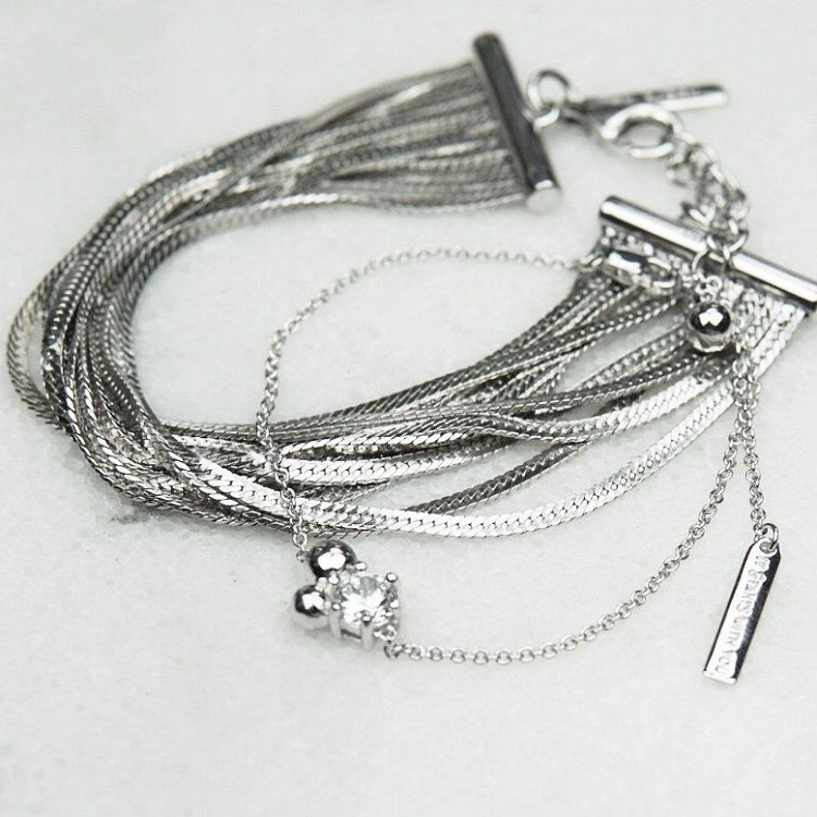 silverarmband till med två silverkulor och sten