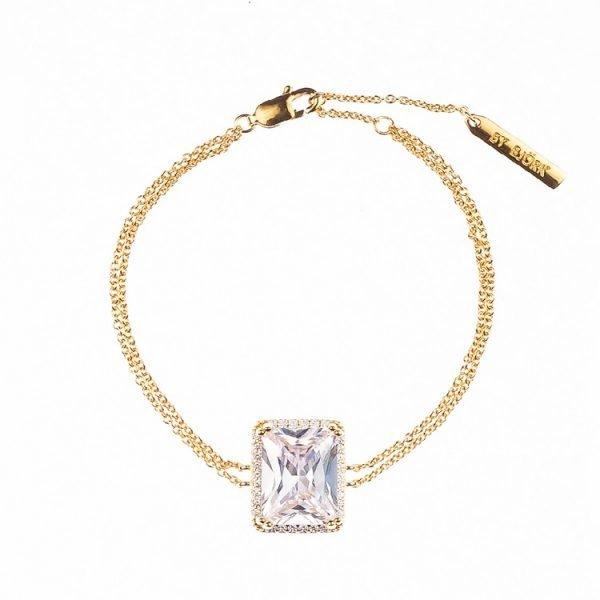 guldarmband med sten